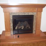 Traditional Style Fireplace with Stone and Wood