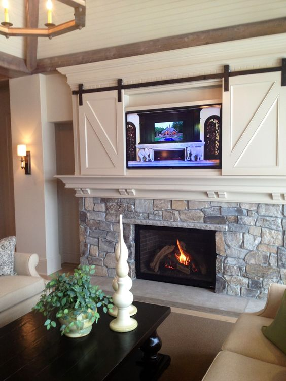 fireplace with white cabinets above.jpg