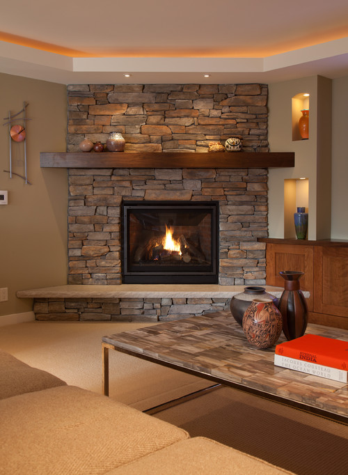 Indoor stone fireplace by La Crosse Fireplace