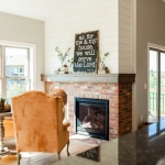 Brick fireplace with shiplap above .jpg