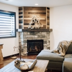 Corner angled fireplace with barn board above .jpg